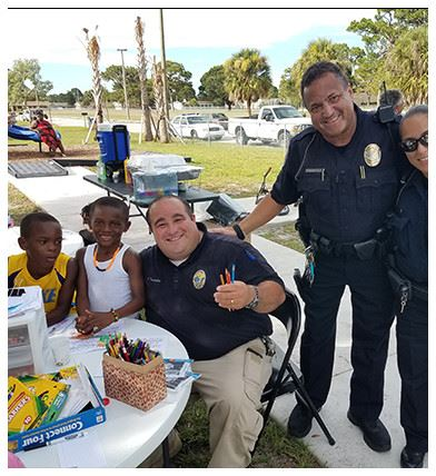 Police officers working on crafts with kids